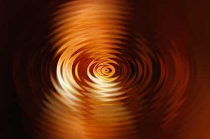 Waves draw circles on orange water