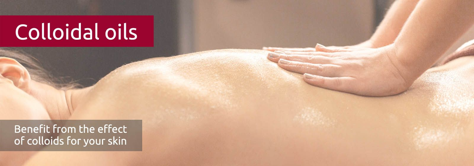 A woman's back is gently massaged and shines with oil