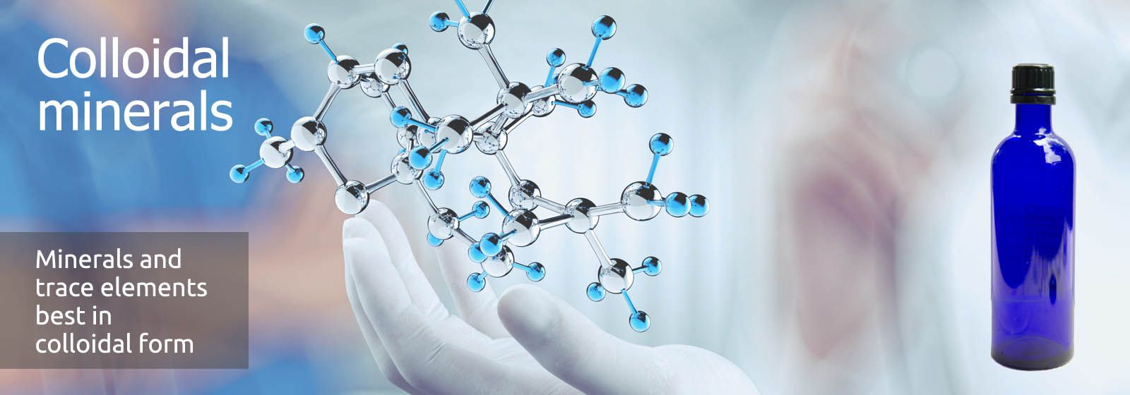 The shiny metal model of a molecule hovers over a white hand